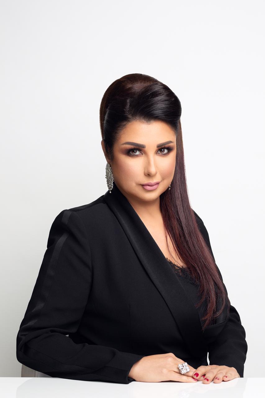 صورة الاعلامية ماريا معلوف في جامعة دبي في يوم المراة العالمي
